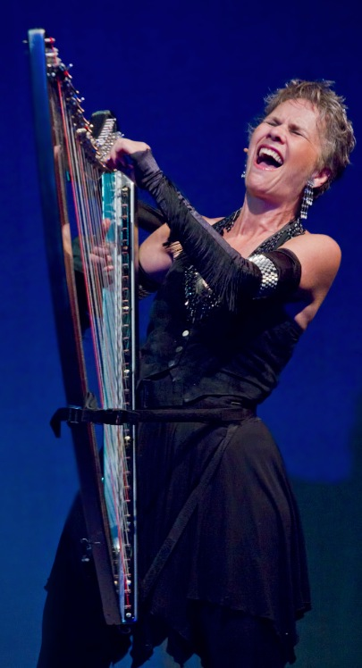 Deborah Henson-Conant in Performance, singing with her electric harp